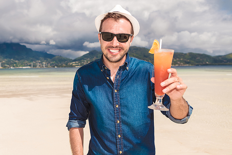 man invites you to a cold drink on the beach